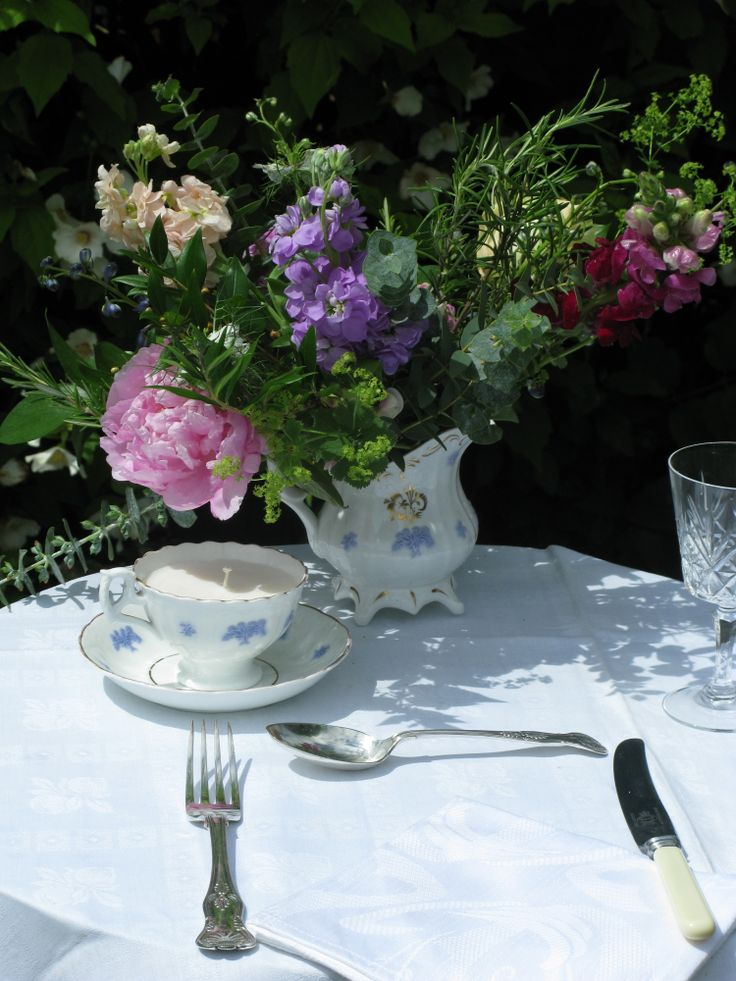 A beautiful Georgian footed teacup and saucer and ensuite milk jug with lilac sprig detailing c 1825
