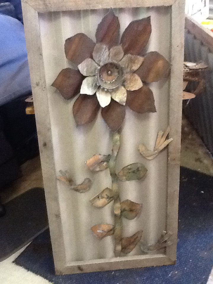 Metal flower picture 300mm x 800mm made from old fencing materials and old pallet for frame.
