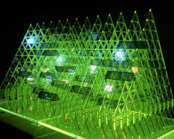 'lost in pascal's triangle' installation - influenced by the mathematic formula of french mathematician blaise pascal, the interactive lighting structure is composed   of 100 triangular LED lights which are supported within a network of various layered fluorescent triangles.