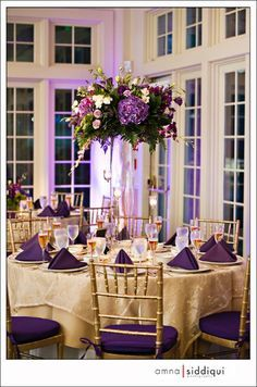 I love the tall wedding centerpiece with flowers and the gold glasses. I would probably add a candle on the table as well