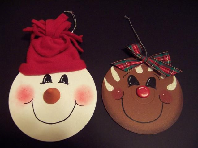 Have a bunch of old cds laying around? Make them into Christmas ornaments! Paint the cd, draw on a face, put colored paper behind the hole, add wire for hanging and any accessories.