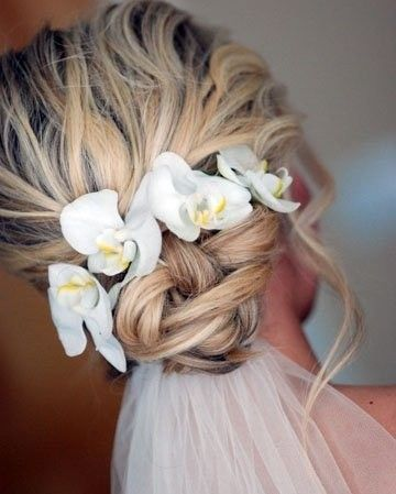 Beach Wedding Hairstyles the fantastic braided updo hair for beach bridal hairstyles 5 Fantastic Beach Wedding Hairstyles With Flower Decorations