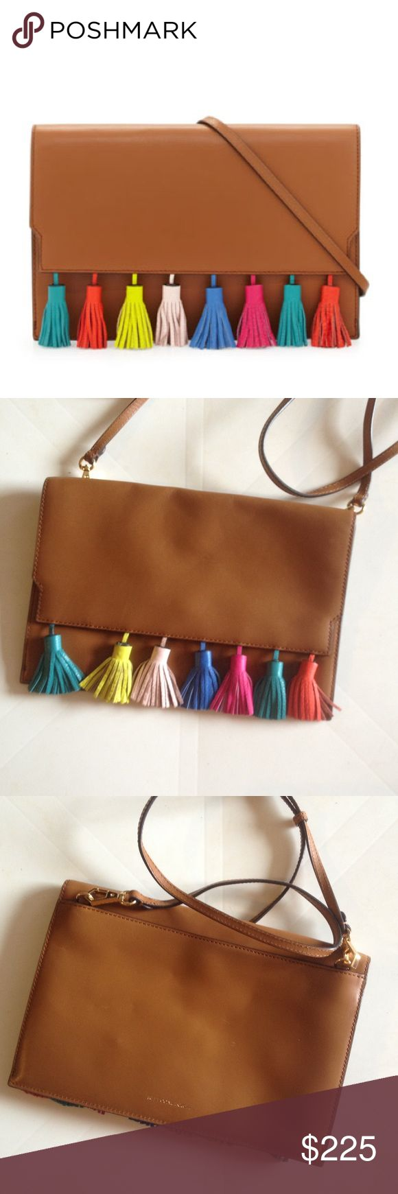 Rebecca Minkoff Sofia Clutch Bag Crossbody Super cute crossbody bag! Sadly missing one tassel  Otherwise, in excellent shape. Measures about 11.5 x 8 x 1 inch. Crossbody strap drop is about 21-25 inches. Open to offers, no trades! Rebecca Minkoff Bags Crossbody Bags