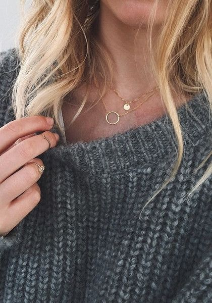 Add a delicate touch to your outfit with this gold circle layered necklace. It features a circle pendant and a paillette charm for a dainty vibe as well as a lobster lock. | Lookbook Store Accessories