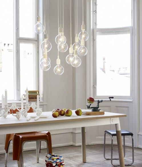 Lifestyle white scandinavian dining room design with minimalist rectangle wooden dining table complete with the wooden dining chairs and the scandinavian