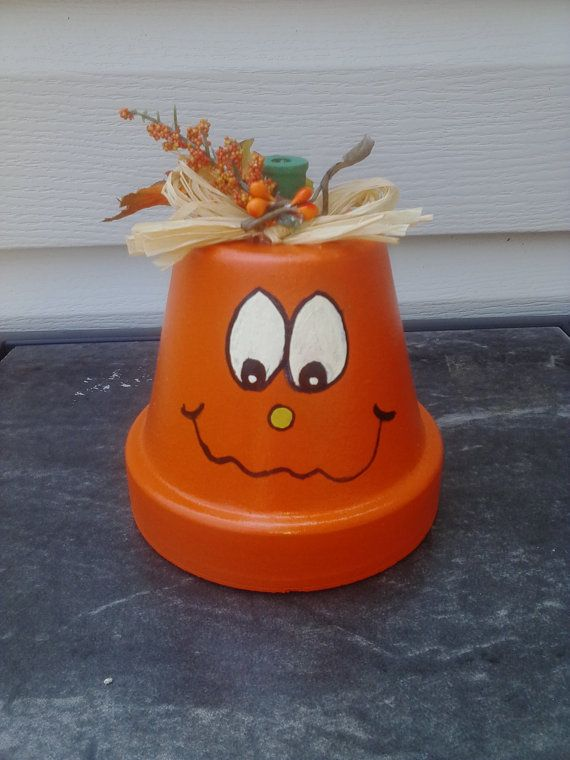 I am rehoming this claypot pumpkin to a good home. :) 5 inches tall including stem 4 inches wide. Hand painted and finished with three coats of