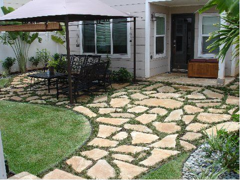 add flagstone pavers beside driveway where spruce will be removed.  Pearl City, HI Flagstone Paving | KONGSTRUCTION, LLC.