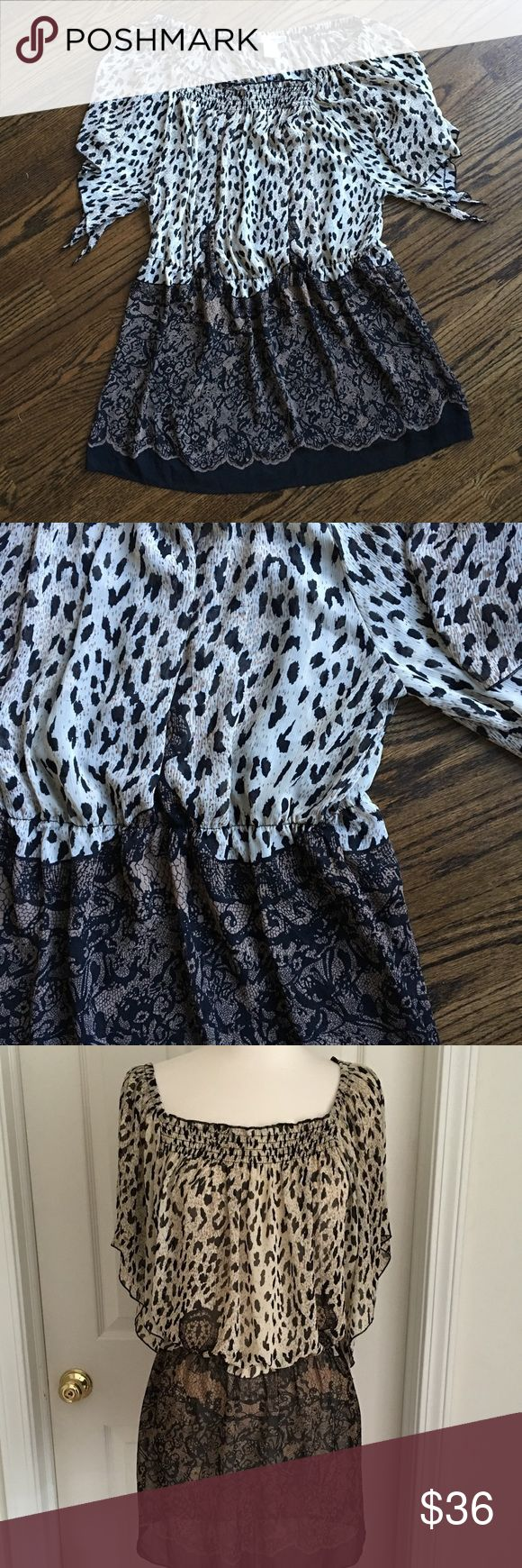 WD NY Woman animal print tunic Meet Elena. She's a soft romantic tunic from WD.NY Woman and she is ready to accompany you to all your holiday events this year. Light flowy fabric in tans, creams and browns skims your body with fluttery batwing short sleeves, an elastic waist to define your middle and darker pattern on the bottom to flatter your figure. Great over jeans, skirts, leggings. Fabric is sheer and looks great with a tank top underneath. 100% polyester, size 2x. WD NY Woman Tops…