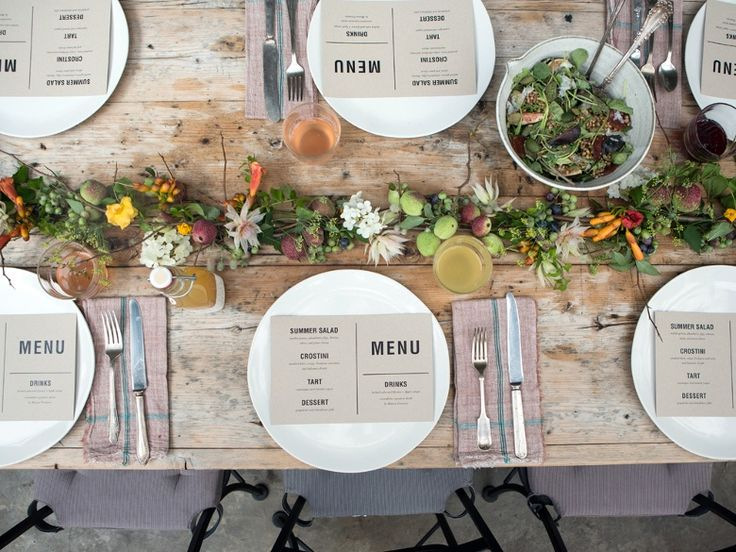 organic table setting with veggies mixed in with the florals