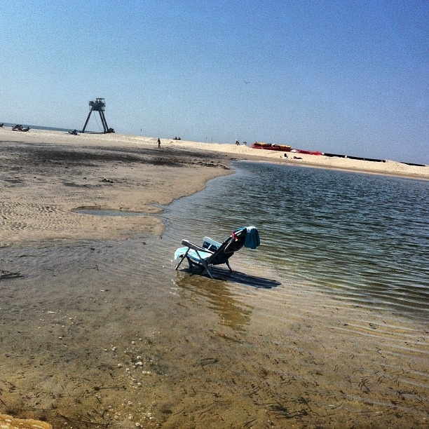 "Townships beaches are crazy! Extremely high dunes, dredging, long beaches, weird cranes!? Might as well tan with some nice water reflection underneath my chair in this ""pond"" lol - iheartlbi.com/..."