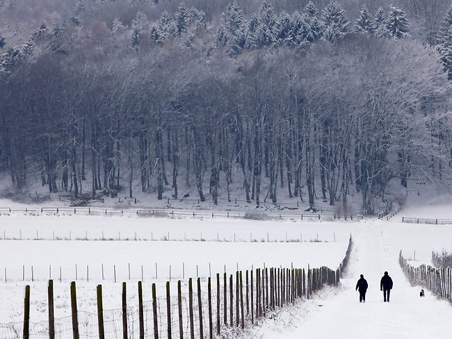 People walk through the snow in Pressisch Oldendorf,northern Germany. Picture: AFP