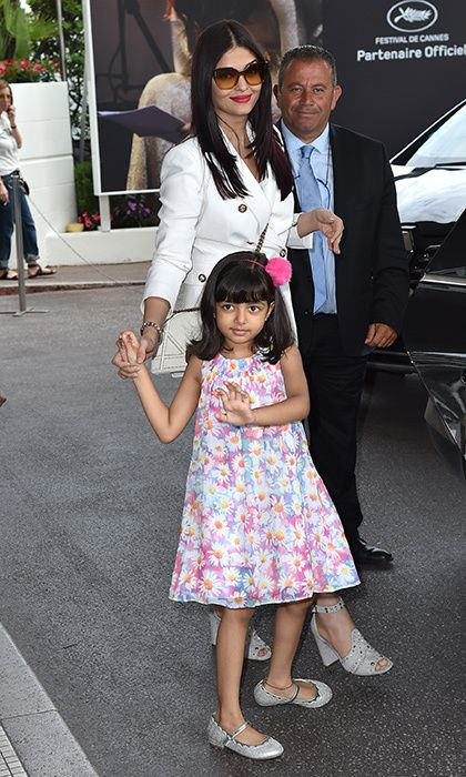 Aishwarya Rai Bachchan's daughter Aaradhya was adorably ready for her own close up as the two stepped out of the Hotel Martinez in Cannes.
