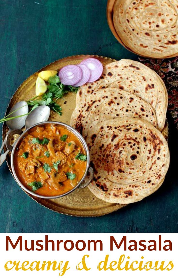 Mushroom masala, a popular, lipsmackingly good, restaurant style Indian gravy curry served with roti, lachcha paratha and pulao