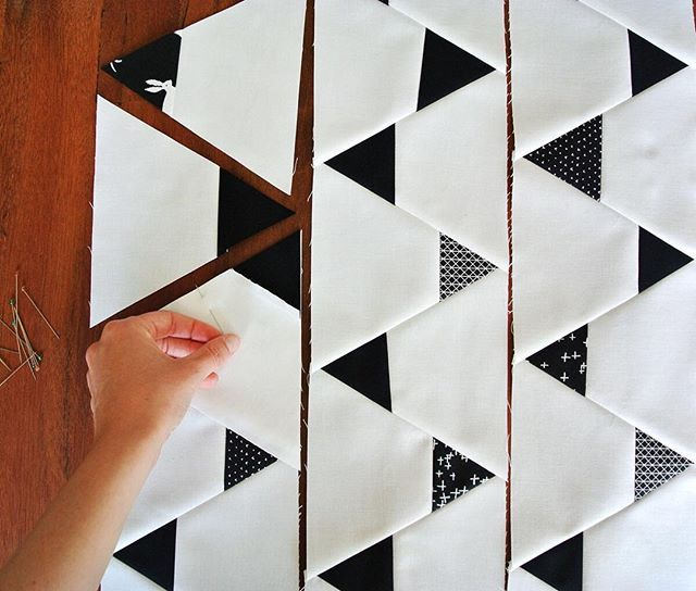 Minimal Triangles Quilt pattern -- would definitely want to make one of these to form a lovely quilt