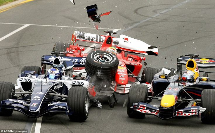 Youll never get your Ferrari through that gap, Felipe. Massa crashes into the Williams of Nico Rosberg (left) and Red Bull driver Christian Klein before spinning off the circuit and out of the 2006 Australian Grand Prix at the first corner on his Ferrari debut