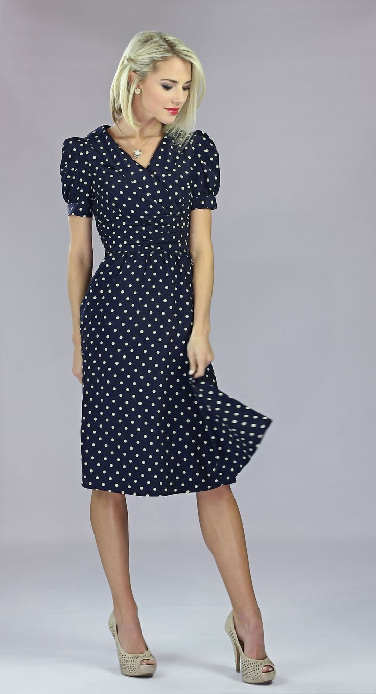 A dress with a vintage air about it- the Ariana dress in Navy Polka Dot is sure to give you that retro vibe you've always wanted- modestly! This dress features a collared wrap neckline, puffed sleeves, and a ruched detailed waistline. $59.99
