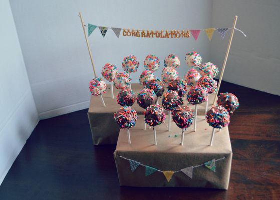 Easy DIY cake (or pie!) pop stand. Cover a shoe box in craft paper and punch holes. The mini bunting and banners add a great touch.