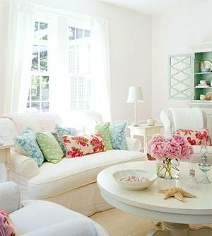Accent your slip covered white sofa with fun bold pillows. Also, you can change out pillow covers with the seasons and completely change the look of your living room:)