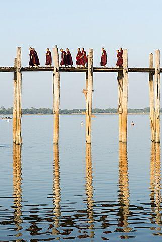 Monks crossing the U Bien bridge across Taungthaman Lake, Amarapura, Mandalay…