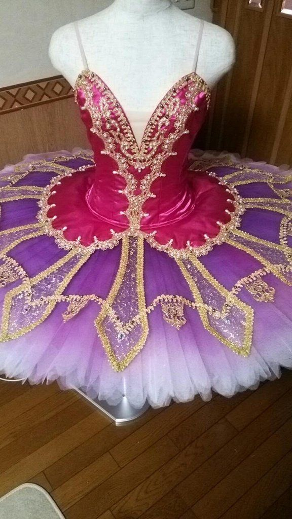 "New exclusive professional tutu. An exceptional creation for the ballet ""Le Corsaire"" that will leave the audience breathless. This tutu features a deep dark pink satin bodice decorated richly with go"