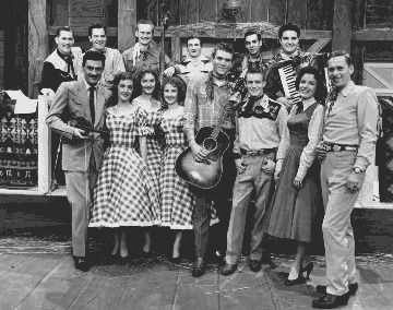 Country Hoedown with King Ganam And His Sons of the West, The Hames Sisters, Tommy Hunter, Tommy Common, Lorraine Foreman and Gordie Tapp (left to right). The show ran from 1956 to 1965, when it was succeeded by the The Tommy Hunter Show.
