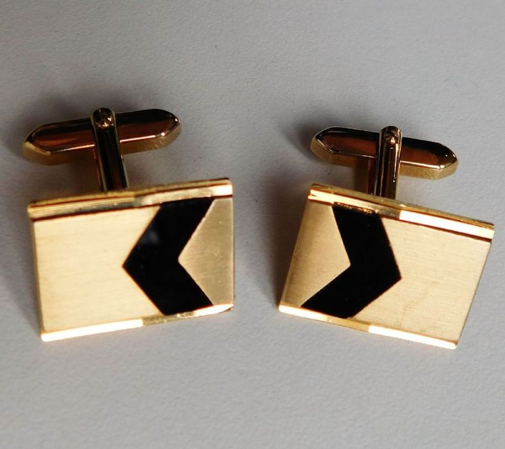 Vintage cufflinks from West Germany Gold coloured metal with black chevron Shanks are marked MADE IN WEST GERMANY These are vintage cufflinks