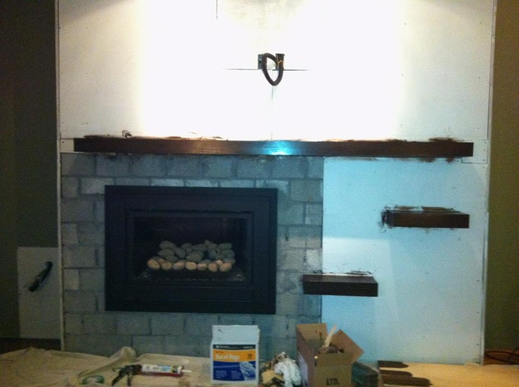Mantel and shelves stained.