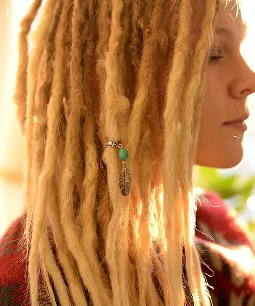 New and old beads can now be found in our shop!  Find this lovely feather dreadlock decoration in our shop here: