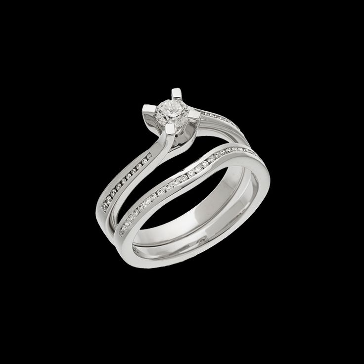 """""""Shiraz"""" has a delicate curve to show off the center round brilliant diamond. This ring has a 0.25 carat round brilliant center diamond."""