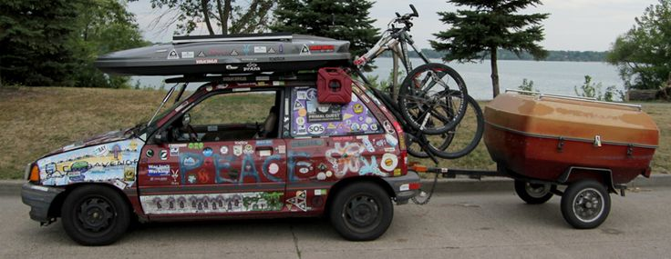 "Modified Ford Festiva is Home, Office, Transport for Traveling Couple -- Sam Salwei lives in a 28-square-foot pod. It was built in 1988, and formerly the car was known as a Ford Festiva. Salwei, a founding member of the YogaSlackers group and a GearJunkie contributor, calls his highly-modified vehicle the PeaceLoveCar.  A solar panel on the roof gives power. The seats fold down into a bed. Under the hood is an oven. ""We bake burritos in the…"
