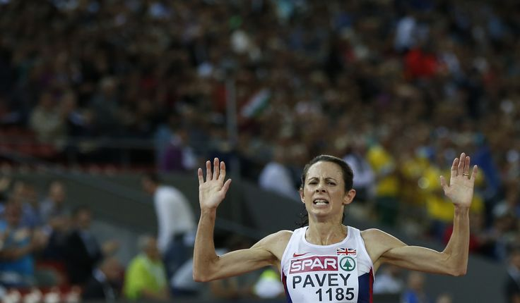 Pavey of Britain celebrates as crosses finish line to win women's 10,000 metres race during European Athletics Championships in Zurich