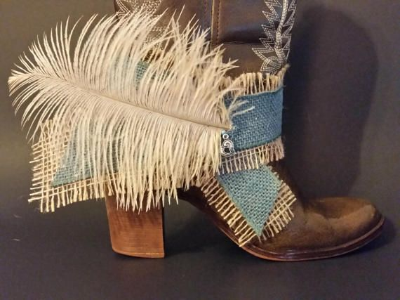 Make an entrance with this exquisite Feather Plume 'Blue Heart' Bootlet. Handcrafted with unfinished tan burlap ribbon (sprayed to lightly tack the edges), beautiful shade of turquoise burlap wire ribbon, with unique cream colored feather and adorned with a silver heart charm and turquoise seed bead. Tan burlap has unfinished edges (sprayed to lightly tack the edges) and is designed to slightly unravel on the edges, adding to the unique charm of this piece. Snip unwanted threads.