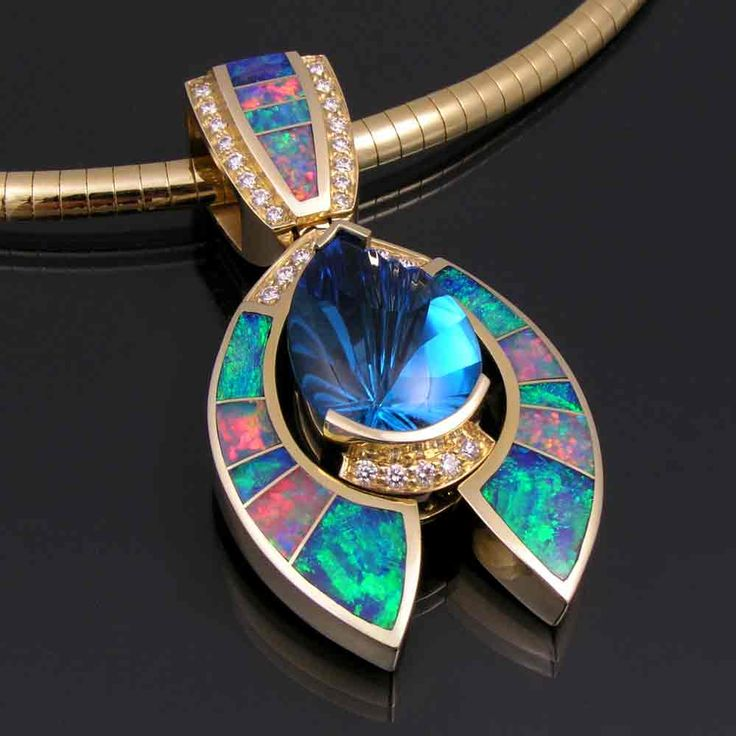 Pendant |  Mark Hileman.   Australian opal pendant in 14k gold with Swiss blue topaz and diamond accents
