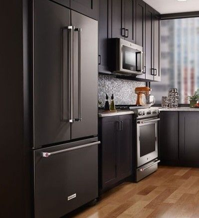 This set of sleek Black Stainless Steel appliances is from KitchenAid; it works incredibly well with the surrounding black cabinetry.