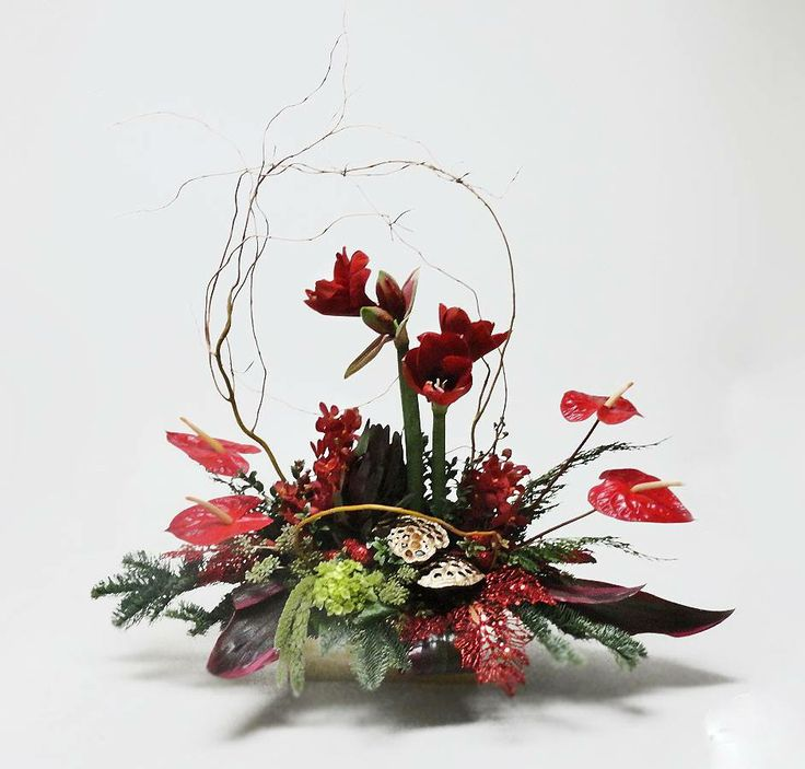 Amaryllis and tropical centerpiece. — at Avante Gardens Florist.