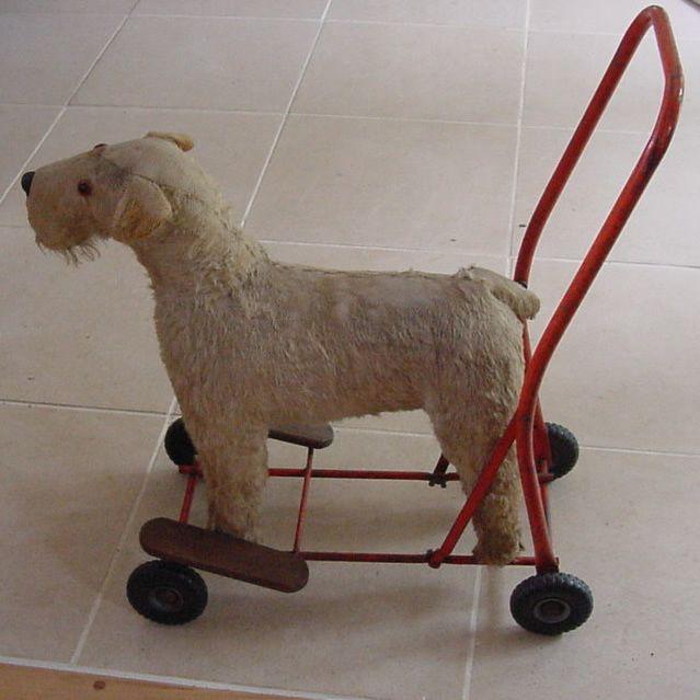 Toy dog on wheels.