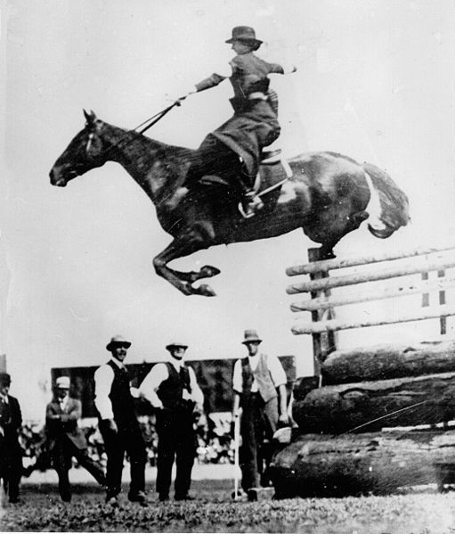 Esther Stace in a side sadle on Emu Plains at Sydney Royal Easter Show 1915 jumping a fence of 1.981m.