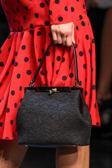 A bold dress and a ladylike bag.