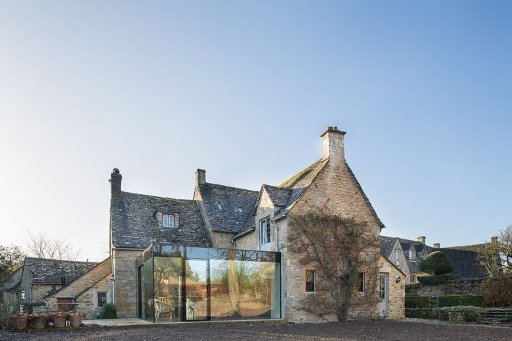 London studio Jonathan Tuckey Design has added a contemporary glazed extension to Yew Tree House, a Grade II-listed Cotswolds house to provide additional space without detracting from the original building