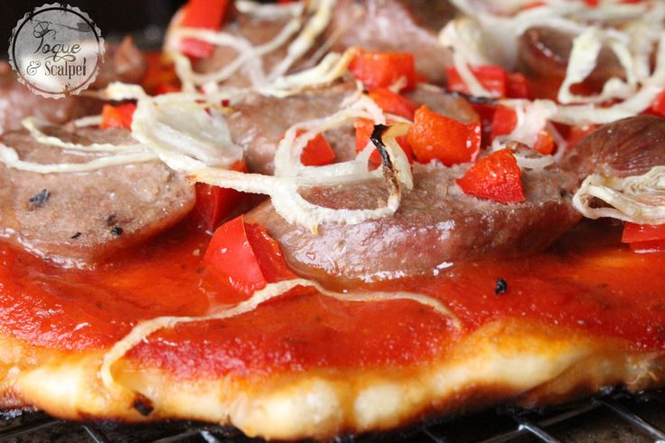 GRILLED PIZZA WITH ITALIAN SAUSAGE, PEPPERS & SHALLOTS - http://www.toqueandscalpel.com/recipe/grilled-pizza-with-italian-sausage-peppers-shallots/