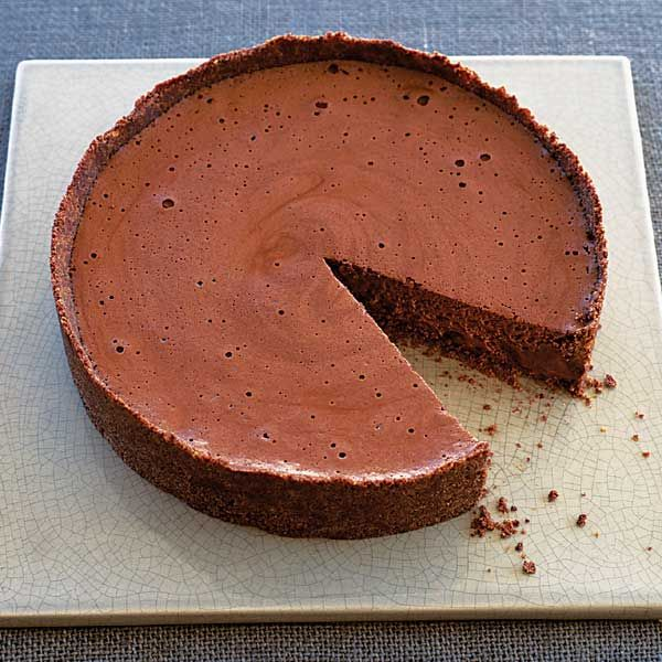 This rich chocolate mousse is encased in a biscuit case – it makes a great make-ahead dessert recipe for dinner parties or special occasions.