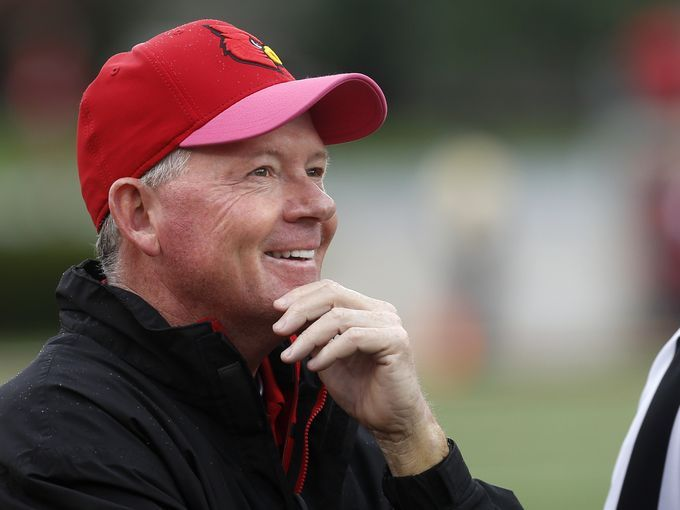 Louisville's coach Bobby Petrino looks at the replay