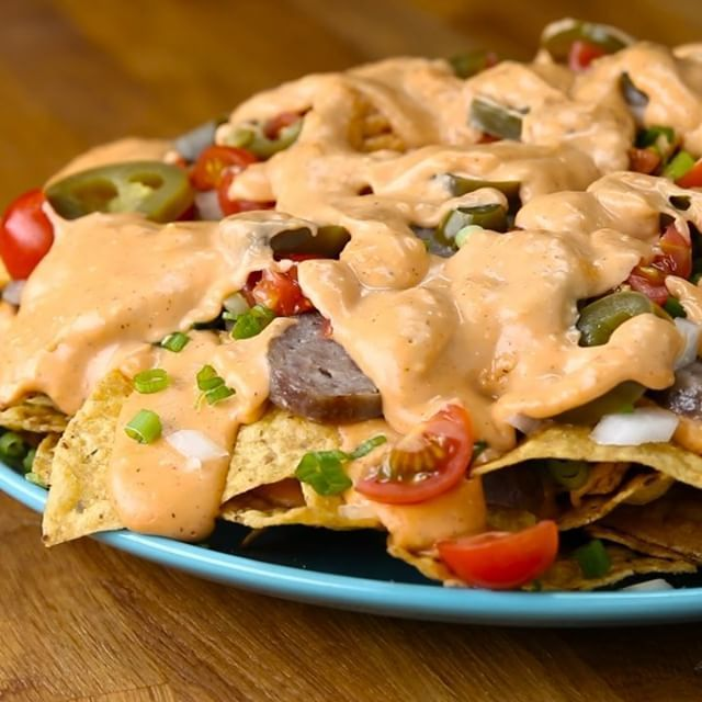 BEER BRAT NACHOS Serves 4-6 INGREDIENTS  1 pound bratwurst 2 cans lager or…