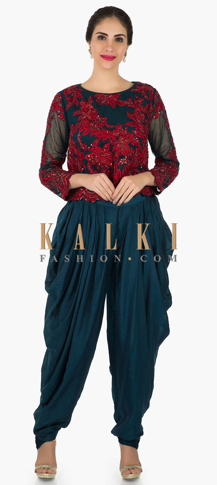 Buy Online from the link below. We ship worldwide (Free Shipping over US$100)  Click Anywhere to Tag Navy blue top in french knot embroidery with fancy cowl drape pants only on Kalki Navy blue top featuring in net with lining. Its embellished in resham french knot and sequin embroidery. Matched with cotton fancy pants in cowl drape.