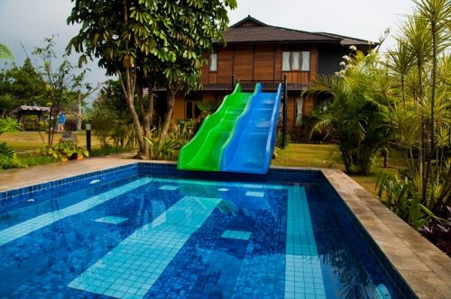 slides into the swimming pool from the roof nice dream house pinterest swimming pools spaces and pool designs