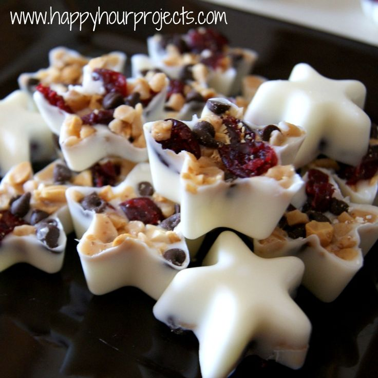 Bite-size Party bark using melted white chocolate, sweet cranberries, toffee & dark chocolate chips in ice cube trays or candy trays.