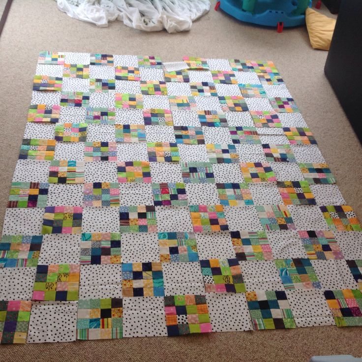 This is my long in coming postage stamp baby quilt that became curtains in the end...