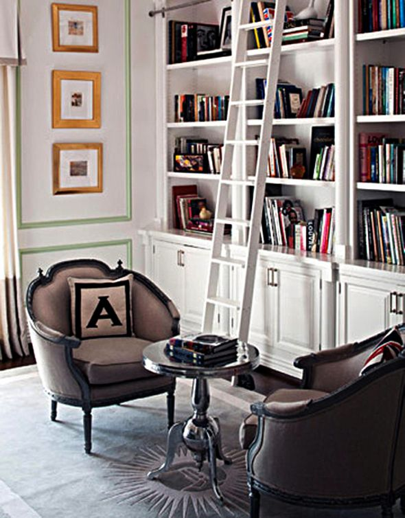 Bookcase with lower cabinets and ladder