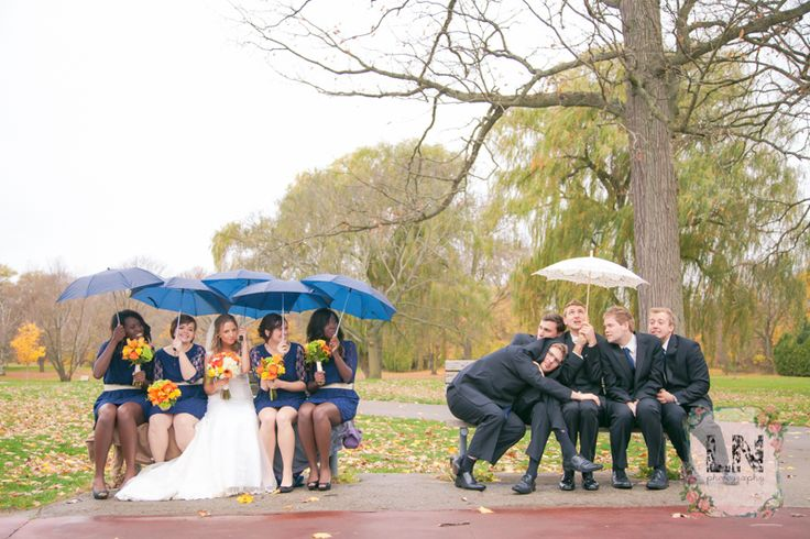 Take silly pictures with your wedding party to brighten a rainy wedding day!