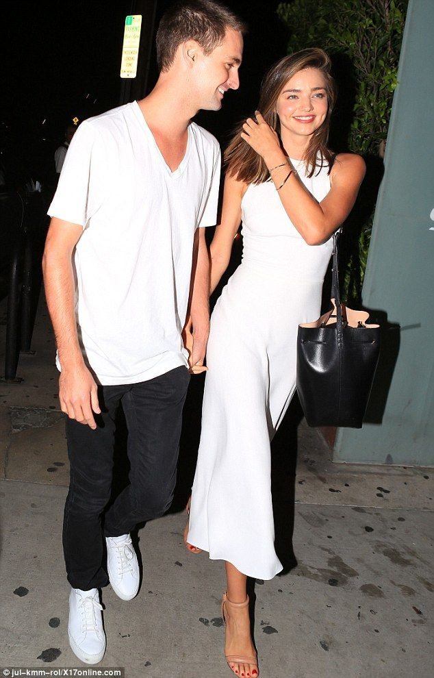 Getting close: The 32-year-old model held hands with Evan, 25, during their romantic date ...